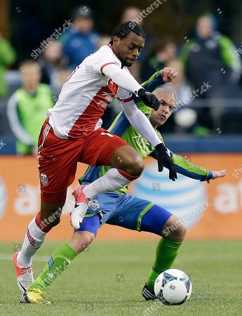 Frederic Piquionne, Osvaldo Alonso Portland Timbers' Frederic Piquionne, left, battles for the ball with Seattle Sounders' Osvaldo Alonso, right, in the second half of an MLS soccer match, in Seattle. The match ended in a 1-1 draw