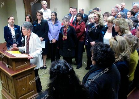 Stock Image of State Sen. Christine Kaufmann, left, leads a news conference of Democrats opposed to a GOP-led rejection of federal family planning money on in Helena, Mont. The House Appropriations Committee blocked a Democratic-led effort Monday to restore the roughly $4 million into the state's main budget bill