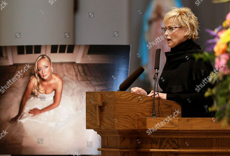 Lorrie Morgan Lorrie Morgan speaks during a memorial service for fellow country singer Mindy McCready, in Nashville, Tenn. McCready committed suicide Feb. 17 in Heber Springs, Ark. Old friends and family members spoke about her difficulties and triumphs during the hour-long remembrance at the Cathedral of the Incarnation