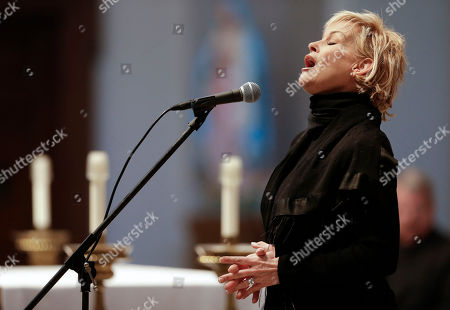 "Lorrie Morgan Lorrie Morgan sings ""Ave Maria"" during a memorial service for fellow country singer Mindy McCready, in Nashville, Tenn. McCready committed suicide Feb. 17 in Heber Springs, Ark. Old friends and family members spoke about her difficulties and triumphs during the hour-long remembrance Wednesday at the Cathedral of the Incarnation"