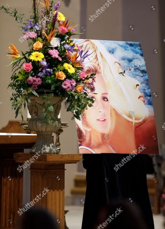 Bryan White A portrait of the late country singer Mindy McCready is displayed during a memorial service for McCready, in Nashville, Tenn. McCready committed suicide Feb. 17 in Heber Springs, Ark