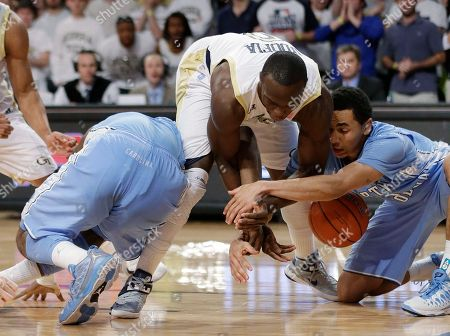 Mfon Udofia, Luke Davis, P J Hairston Georgia Tech guard Mfon Udofia, center, vies with North Carolina guards Luke Davis, right, and P.J. Hairston (15) for a loose ball in the second half of an NCAA college basketball game, in Atlanta. North Carolina won 70-58