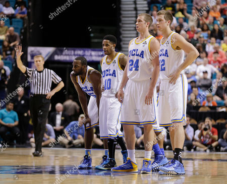 From left, UCLA's Shabazz Muhammad, Larry Drew II (10), Travis Wear (24) and David Wear (12) watch as Oregon shoots a free throw on a technical foul in the first half of the Pac-12 tournament championship NCAA college basketball game, in Las Vegas