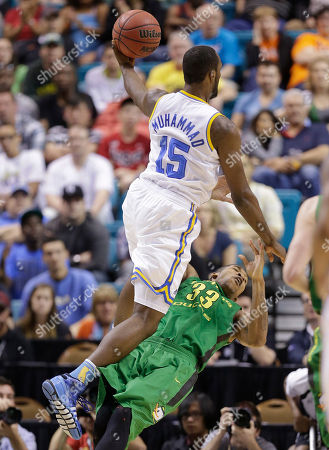 UCLA's Shabazz Muhammad collides with Oregon's Carlos Emory as he drives in for a basket in the first half of the NCAA college basketball game in the Pac-12 Conference tournament, in Las Vegas. Muhammad was charged with an offensive foul on the play, and the UCLA bench was charged with a technical foul