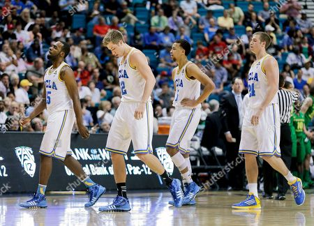 UCLA players, from left, Shabazz Muhammad, David Wear, Kyle Anderson and Travis Wear walk off the court during a timeout against Oregon in the championship NCAA college basketball game in the Pac-12 Conference tournament, in Las Vegas. Oregon won 78-69
