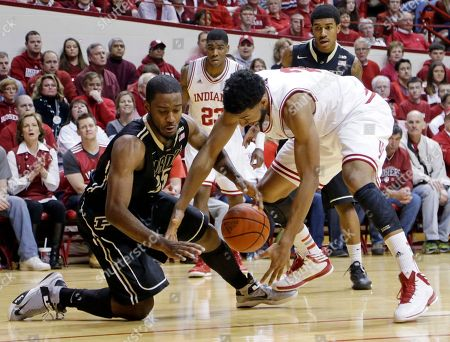 Christian Watford, Rapheal Davis Purdue guard Rapheal Davis, left, and Indiana forward Christian Watford go for a loose ball in the second half of a NCAA college basketball game in Bloomington, Ind., . Indiana defeated Purdue 83-55