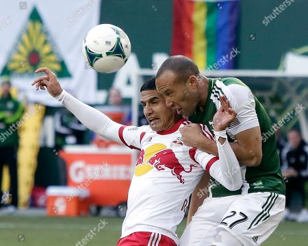 Mikael Silvestre, Tim Cahill Portland Timbers defender Mikael Silvestre, right, and New York Red Bulls midfielder Tim Cahill battle for the ball during the first half of an MLS soccer game in Portland, Ore