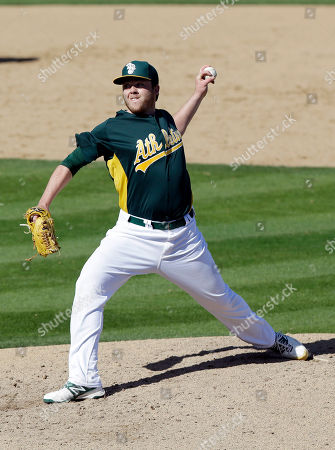 Andrew Werner Oakland Athletics' Andrew Werner throws to the Colorado Rockies during an exhibition spring training baseball game on in Phoenix