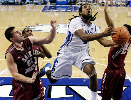 Langston Galloway, Jordair Jett, Halil Kanacevic Saint Louis guard Jordair Jett, right, heads to the basket past Saint Joseph's forward Halil Kanacevic, front left, and guard Langston Galloway during the second half of an NCAA college basketball game, in St. Louis. Saint Louis won 70-53