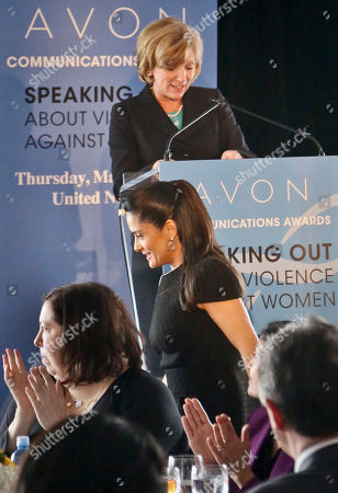 "Stock Photo of Mexican actress and advocate Salma Hayek, bottom center, is applauded as Avon CEO Sheri McCoy, top center, invites her to speak during the ""2nd Annual Avon Communications Awards: Speaking Out About Violence Against Women"" luncheon, at the 57th session of the Commission on the Status of Women conference at the U.N. headquarters"