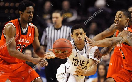 Texas A&M guard Jordan Green (13) passes the ball under pressure from Auburn forward Noel Johnson, left, and guard Chris Denson (3) during the second half of an NCAA college basketball game at the Southeastern Conference tournament, in Nashville, Tenn