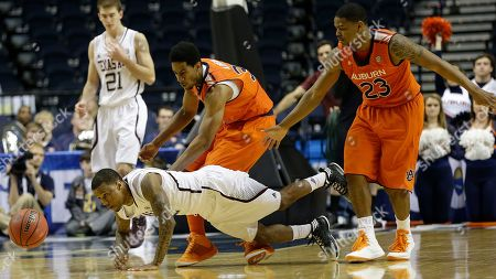 Texas A&M guard Fabyon Harris (12) vies for a loose ball as Auburn forward Noel Johnson (32) and Auburn guard Frankie Sullivan (23) defend during the second half of an NCAA college basketball game at the Southeastern Conference tournament, in Nashville, Tenn. Texas A&M won 71-62