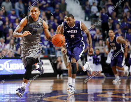 Rodney McGruder, Connell Crossland Kansas State guard Rodney McGruder (22) leads a fast break past TCU forward Connell Crossland (2) during the second half of an NCAA college basketball game in Manhattan, Kan., . Kansas State defeated TCU 79-68