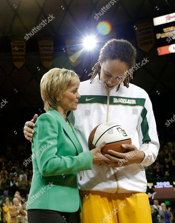 Kim Mulkey, Brittney Griner Baylor head coach Kim Mulkey left, hands Brittney Griner, right, a trophy basketball during a pregame ceremony before an NCAA college basketball game against Texas, in Waco, Texas. Griner was honored before the game for becoming the eighth Division I woman with 3,000 career points in Monday's win at No. 3 Connecticut. She moved up to No. 5 on the career list, passing Cindy Blodgett (Maine), Cheryl Miller (Southern California) and Chamique Holdsclaw (Tennessee). She's six points behind UConn's Maya Moore. Baylor defeated Texas 67-47