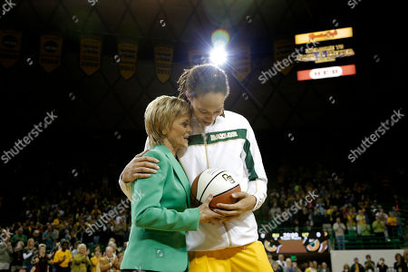 Brittney Griner, Kim Mulkey Baylor head coach Kim Mulkey left, honors Brittney Griner, right, with trophy basketball celebrating her 3000th point before an NCAA college basketball game, in Waco, Texas. Griner was honored before the game for becoming the eighth Division I woman with 3,000 career points in Monday's win at No. 3 Connecticut. She moved up to No. 5 on the career list, passing Cindy Blodgett (Maine), Cheryl Miller (Southern California) and Chamique Holdsclaw (Tennessee). She's six points behind UConn's Maya Moore
