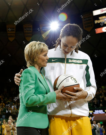 Kim Mulkey, Brittney Griner Baylor head coach Kim Mulkey left, honors Brittney Griner, right, with trophy basketball celebrating her 3000th point before an NCAA college basketball game, in Waco, Texas. Griner was honored before the game for becoming the eighth Division I woman with 3,000 career points in Monday's win at No. 3 Connecticut. She moved up to No. 5 on the career list, passing Cindy Blodgett (Maine), Cheryl Miller (Southern California) and Chamique Holdsclaw (Tennessee). She's six points behind UConn's Maya Moore