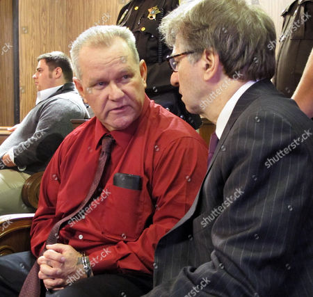 Randolph Arledge, left, speaks to one of his attorneys, Innocence Project co-director Barry Scheck, before a court hearing in Corsicana, Texas, on . Arledge was released from prison after three decades after new DNA evidence showed he was wrongfully convicted of a 1981 murder