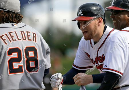 Freddie Freeman, Prince Fielder, Terry Pendleton Atlanta Braves' Freddie Freeman, center, reacts after getting the first hit of the game as Detroit Tigers first baseman Prince Fielder (28) stands near him during an exhibition baseball game, in Kissimmee, Fla. Braves first base coach Terry Pendleton is right