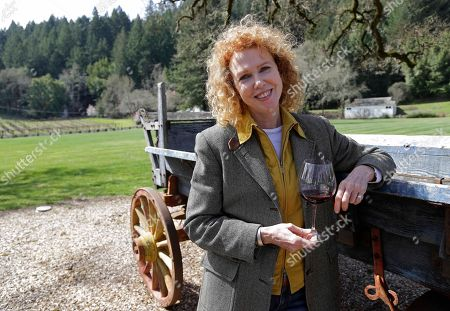 """Kate MacMurray Kate MacMurray, daughter of the late actor Fred MacMurray poses by an old wooden wagon used for diversified farming in World War II and then for cattle at the MacMurray Ranch in Healdsburg, Calif. The former cattle ranch which was purchased in 1941 by the actor in the popular TV series """"My Three Sons,"""" now produces wine and is owned by the Gallo wine family"""