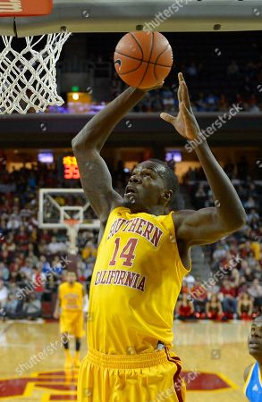 Stock Photo of Dewayne Dedmon Southern California forward Dewayne Dedmon puts up a shot during the first half their NCAA college basketball game, in Los Angeles