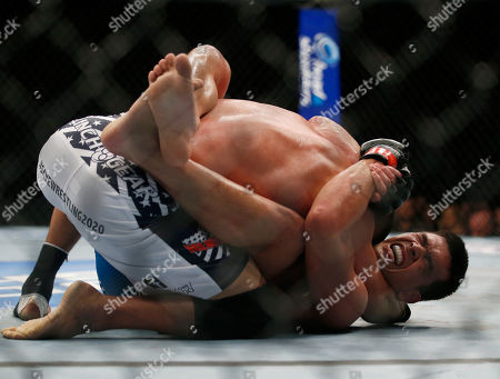 Lyoto Machida, Dan Henderson Lyoto Machida, bottom, and Dan Henderson fight during their UFC 157 light heavyweight mixed martial arts match in Anaheim, Calif., . Machida won by split decision after the third round