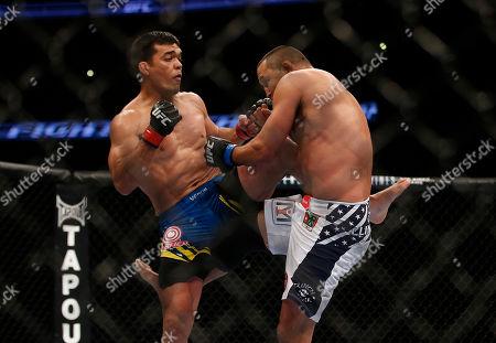 Lyoto Machida Dan Henderson during their UFC 157 light heavyweight mixed martial arts match in Anaheim, Calif., . Machida won by split decision after the third round