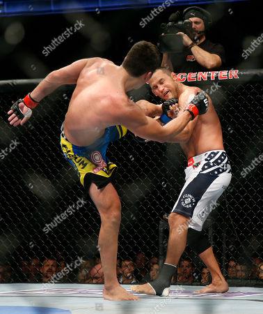 Lyoto Machida, Dan Henderson Lyoto Machida, left, of Brazil, kicks Dan Henderson during their UFC 157 light heavyweight mixed martial arts match in Anaheim, Calif., . Machida won by split decision after the third round