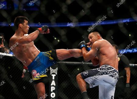 Lyoto Machida, Dan Henderson Lyoto Machida, left, kicks Dan Henderson during their UFC 157 light heavyweight mixed martial arts match in Anaheim, Calif