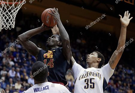 Dewayne Dedmon, Richard Solomon Southern California's Dewayne Dedmon (14) shoots over California's Richard Solomon (35) and Tyrone Wallace during the first half of an NCAA college basketball game, in Berkeley, Calif