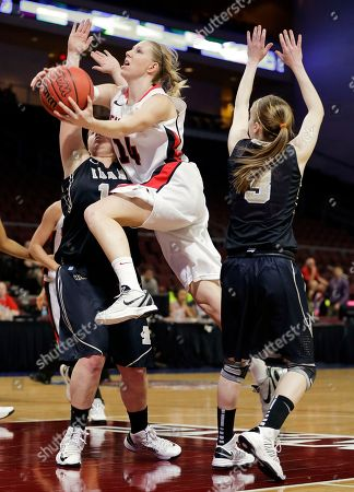 Seattle's Ashley Ward (14) shoots against Idaho's Stacey Barr, left, and Krissy Karr in the second half of their NCAA college basketball game in the Western Athletic Conference tournament championship, in Las Vegas. Idaho won 67-64