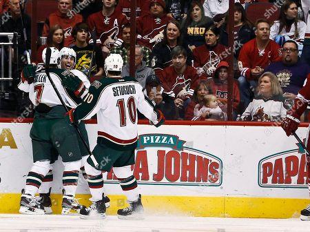 Jason Zucker, Matt Cullen, Devin Setoguchi Minnesota Wild's Jason Zucker celebrates his goal against the Phoenix Coyotes with Matt Cullen (7) and Devin Setoguchi (10) during the first period in an NHL hockey game, in Glendale, Ariz