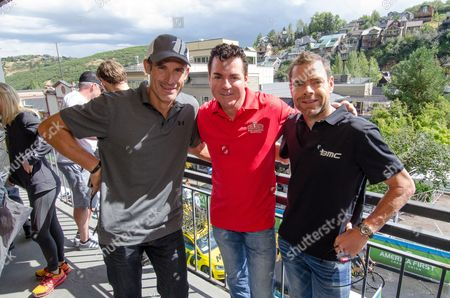 Stock Image of George Hincapie, 'Papa John' Schnatter, and Cadel Evans before the Tour of Utah cycling race, in Park City, Utah. The company sponsored the Rider Sign-In and Autograph Alley