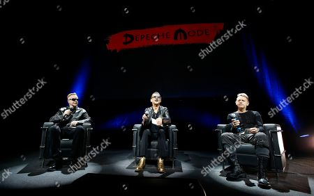 Stock Photo of From left, Andrew Fletcher, Dave Gahan and Martin Gore, of the British band Depeche Mode, attend a press conference to promote their upcoming tour and new album in Milan, Italy