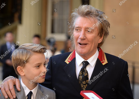 Sir Rod Stewart at his investiture at Buckingham Palace with Aiden Stewart