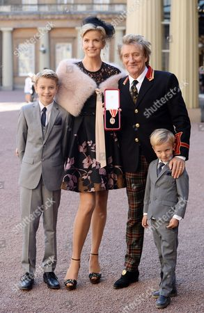 Sir Rod Stewart at his investiture at Buckingham Palace with wife Penny Lancaster and children Alastair Stewart and Aiden Stewart