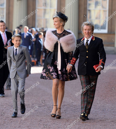 Sir Rod Stewart at his investiture at Buckingham Palace with wife Penny Lancaster and Aiden Stewart
