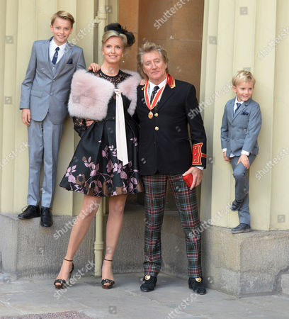 Sir Rod Stewart at his investiture at Buckingham Palace with wife Penny and children Alastair Stewart and Aiden Stewart