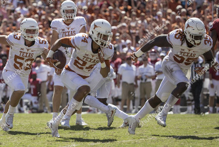 Texas Longhorns cornerback John Bonney (24) picks up a fumble and runs toward the end zone with a group of blockers during the NCAA football game between the Texas Longhorns and the Oklahoma Sooners at the Cotton Bowl in Dallas, TX. The Sooners defeated the Longhorns 45-40; Tim Warner/CSM