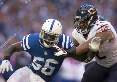 Indianapolis Colts linebacker Akeem Ayers (56) rushes the quarterback as Chicago Bears ofensive lineman Charles Leno (72) attempts to block during NFL football game action between the Chicago Bears and the Indianapolis Colts at Lucas Oil Stadium in Indianapolis, Indiana. Indianapolis defeated Chicago 29-23