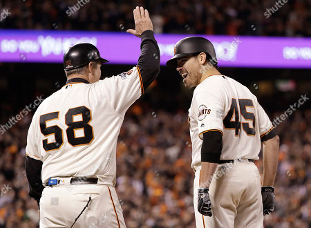 Matt Moore, Bill Hayes San Francisco Giants' Matt Moore (45) reacts with first base coach Bill Hayes (58) after hitting a run-scoring single against the Chicago Cubs during the fourth inning of Game 4 of baseball's National League Division Series in San Francisco