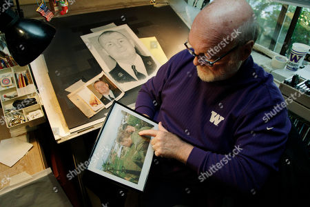 Michael Reagan Artist Michael Reagan holds a photo of himself as a Marine in Vietnam in 1967 as he works at his drawing table on a portrait of Joseph A. Weems, who died after being after being hit by a train while riding his bicycle near the Ramstein Air Base in Germany as he served in the U.S. Air Force, at his home in Edmonds, Wash. Since starting the Fallen Heros Project in 2004, Reagan has drawn more than 3,000 portraits and given them free-of-charge to families of fallen soldiers