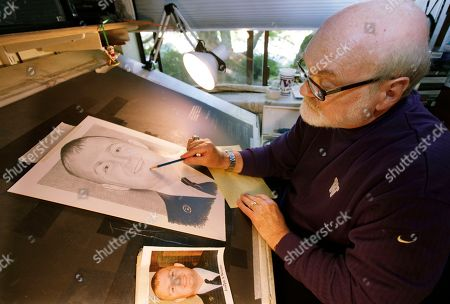 Michael Reagan Artist Michael Reagan works on a portrait of Joseph A. Weems, who died after being after being hit by a train while riding his bicycle near the Ramstein Air Base in Germany as he served in the U.S. Air Force, at his home in Edmonds, Wash. Since starting the Fallen Heros Project in 2004, Reagan has drawn more than 3,000 portraits and given them free-of-charge to families of fallen soldiers
