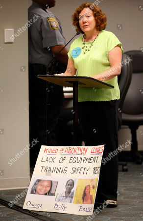 Kathy Brown Kathy Brown displays a sign as she speaks during the Virginia Board of Health meeting on abortion clinic regulations in Richmond, Va., . Brown supported the new clinic regulations