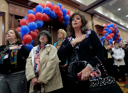 Supporters sing God Bless America during a watch party for U.S. Senate candidate, Rep. Todd Akin, R-Mo., in Chesterfield, Mo