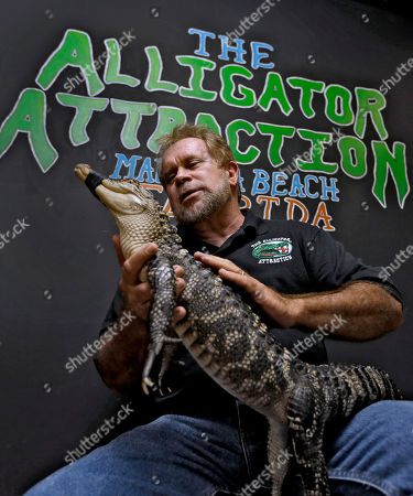 Bob Barrett, Alligators Bob Barrett, owner of The Alligator Attraction poses with one of his alligators in Madeira Beach, Fla. Instead of bounce houses and ponies, some Florida parents are opting for more exciting activities at their kid's birthday parties: alligators. Barrett says the parties are totally safe, because the alligators mouths are taped shut