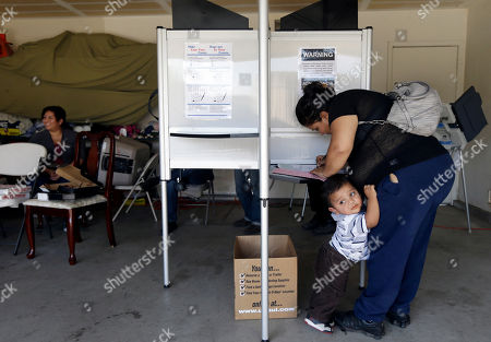 Yesenia Perez, Eduardo Sanchez Yesenia Perez marks her ballot as her 1-year-old Eduardo Sanchez clings to her in the Weston Ranch area of Stockton, Calif. on . The neighborhood was heavily affected by foreclosures in the past few years. Perez, 34, a mother of five who works at a local fruit-packing house, has had her share of hard times. After both she and her husband had their work hours cut amid the sputtering economy, they lost their home to foreclosure three years ago. Yet on Tuesday, she felt compelled to do something she had never done before: vote