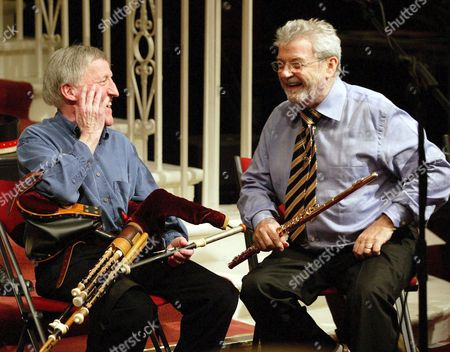 Paddy Maloney of The Chieftains and Sir James Galway share a joke at rehearsals for 'Ireland's finest concert' to mark the Silver Jubilee of the National concert hall in Dublin