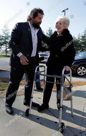 """Stock Image of Rupert Boneham Indiana gubernatorial candidate Libertarian Rupert Boneham helps voter Marilyn Loux over a curb as he greeted voters outside a polling place in Indianapolis, . Boneham faces Democrat John Gregg and Republican Mike Pence in the gubernatorial race. Boneham was a contestant on the reality show """"Survivor"""