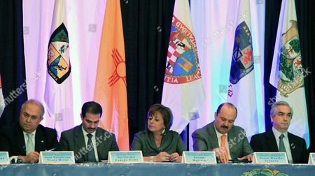 From left to right, Baja California Gov. Jose Guadalupe Osuna Millan, Sonora Gov. Guillermo Padres Elias, New Mexico Gov. Susana Martinez, Chihuahua Gov. Cesar Duarte Jaquez and Nuevo Leon representative Carlos Almada discuss their recommendations during the closing ceremony of the 30th annual Border Governors Conference in Albuquerque, N.M., on