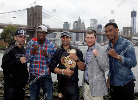 Luis Collazo, Peter Quillin, Paul Malignaggi, Dmitriy Salita, Danny Jacobs Brooklyn, N.Y., boxers from left, Luis Collazo, Peter Quillin, Paul Malignaggi the current WBA Welterweight Champion, Dmitriy Salita, and Danny Jacobs, pose near the Brooklyn Bridge, in the Brooklyn borough of New York, . They are scheduled to be on the undercard Saturday night before the Danny Garcia-Erik Morales Super Lightweight bout at the Barclays Center in Brooklyn